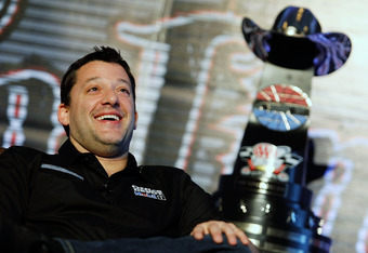 FORT WORTH, TX - MARCH 06:  Tony Stewart, driver of the #14 Office Depot/Mobil 1 Chevrolet, jokes with Texas Motor Speedway President Eddie Gossage during Media Day at Texas Motor Speedway on March 6, 2012 in Fort Worth, Texas.  (Photo by Tom Pennington/G
