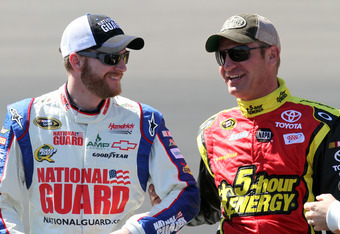 AVONDALE, AZ - MARCH 03:  Dale Earnhardt Jr., driver of the #88 National Guard/ Diet Mountain Dew Chevrolet, and Clint Bowyer, driver of the #15 5-hour Energy Toyota, talk on the grid during qualifying for the NASCAR Sprint Cup Series SUBWAY Fresh Fit 500