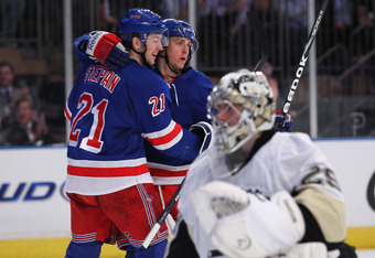 Stepan and Hagelin celebrate a goal.