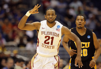 SAN ANTONIO, TX - MARCH 25:  Michael Snaer #21 of the Florida State Seminoles celebrates after a three point shot against the Virginia Commonwealth Rams during the southwest regional of the 2011 NCAA men's basketball tournament at the Alamodome on March 2