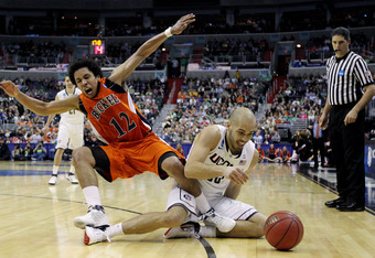 WASHINGTON - MARCH 17:  Benjamin Stewart #23 of the Connecticut Huskies fights for a loose ball with Bryson Johnson #12 of the Bucknell Bison during the second round of the 2011 NCAA men's basketball tournament at the Verizon Center on March 17, 2011 in W