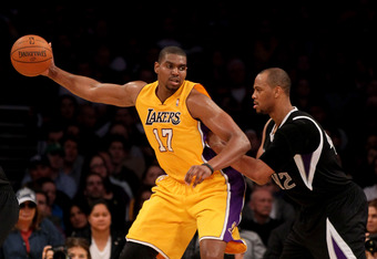 LOS ANGELES, CA - MARCH 02:  Andrew Bynum #17 of the Los Angeles Lakers catches a pass in front of Chuck Hayes #42 of the Sacramento Kings at Staples Center on March 2, 2012 in Los Angeles, California.  The Lakers won 115-107.  NOTE TO USER: User expressl