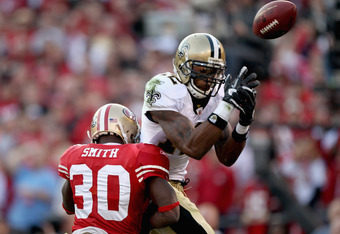 SAN FRANCISCO, CA - JANUARY 14:  Reggie Smith #30 of the San Francisco 49ers forces an incomplete pass against Marques Colston #12 of the New Orleans Saints during the fourth quarter of the NFC Divisional playoff game at Candlestick Park on January 14, 20