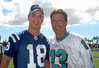 Indianapolis Colts quarterback Peyton Manning  and Miami Dolphins quarterback Dan Marino pose for a photo  during a flag-football legends  game during 2005 Pro Bowl week in Ko Olina, Honolulu February 11, 2005.  (Photo by Al Messerschmidt/Getty Images)