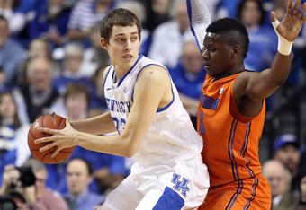 LEXINGTON, KY - FEBRUARY 07:  Kyle Wiltjer #33 of the Kentucky Wildcats looks to pass the ball while defended by Will Yeguete #15 of the Florida Gators during the game at Rupp Arena on February 7, 2012 in Lexington, Kentucky.  (Photo by Andy Lyons/Getty I
