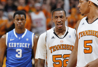 KNOXVILLE, TN - JANUARY 14: Jordan McRae #52 of the Tennessee Volunteers celebrates ahead of Terrence Jones #3 of the Kentucky Wildcats at Thompson-Boling Arena on January 14, 2012 in Knoxville, Tennessee. Kentucky defeated Tennessee 65-62. (Photo by Joe