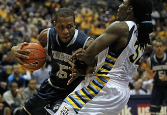 MILWAUKEE, WI - MARCH 03:  Jabril Trawick #55 of the Georgetown Hoyas charges against Jae Crowder #32 of the Marquette Golden Eagles at the Bradley Center on March 3, 2012 in Milwaukee, Wisconsin. Marquette defeated Georgetown 83-69.  (Photo by Jonathan D