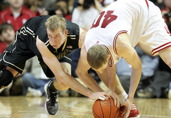 Robbie Hummel (left) and Cody Zeller battle for a loose ball in their March 4 matchup.