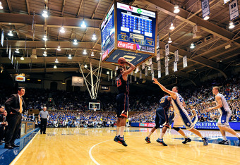 DURHAM, NC - JANUARY 12:  Coach Tony Bennett watches as Mike Scott #23 of the Virginia Cavaliers shoots a three-point shot against the Duke Blue Devils during play at Cameron Indoor Stadium on January 12, 2012 in Durham, North Carolina. Duke won 61-58.  (