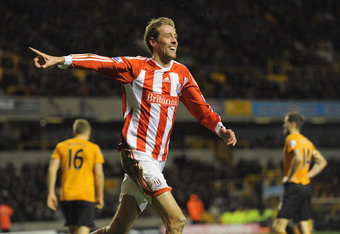 WOLVERHAMPTON, ENGLAND - DECEMBER 17:  Peter Crouch of Stoke celebrates scoring to make it 2-1 during the Barclays Premier League match between  Wolverhampton Wanderers and Stoke City at Molineux on December 17, 2011 in Wolverhampton, England.  (Photo by