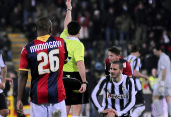 BOLOGNA, ITALY - MARCH 07:  The referee shows a red card to Leonardo Bonucci # 19 of Juventus FC during the Serie A match between Bologna FC and Juventus FC at Stadio Renato Dall'Ara on March 7, 2012 in Bologna, Italy.  (Photo by Mario Carlini / Iguana Pr