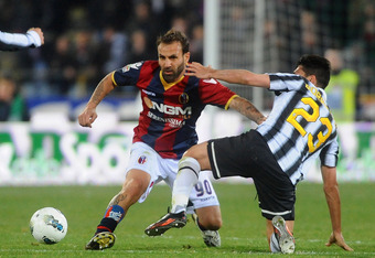 BOLOGNA, ITALY - MARCH 07: Daniele Portanova # 90 of Bologna FC ( L ) competes the ball with Marco Borriello # 23 of Juventus FC ( R ) during the Serie A match between Bologna FC and Juventus FC at Stadio Renato Dall'Ara on March 7, 2012 in Bologna, Italy
