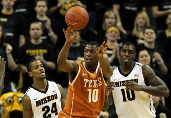 COLUMBIA, MO - JANUARY 14:  Jonathan Holmes #10 of the Texas Longhorns looks to pass as Kim English #24 and Ricardo Ratliffe #10 of the Missouri Tigers defend during the game on January 14, 2012 at Mizzou Arena in Columbia, Missouri.  (Photo by Jamie Squi