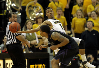 COLUMBIA, MO - FEBRUARY 21:  Phil Pressey #1 of the Missouri Tigers lunges for a ball over the back of Rodney McGruder #22 of the Kansas State Wildcats during the game on February 21, 2012 at Mizzou Arena in Columbia, Missouri.  (Photo by Jamie Squire/Get