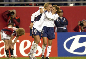 A young Abby Wambach celebrates with Mia Hamm