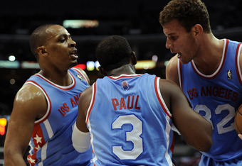 LOS ANGELES, CA - FEBRUARY 22:  Chris Paul #3 of the Los Angeles Clippers gets helped up from Randy Foye #3 and Blake Griffin during a 103-95 win over the Denver Nuggets at Staples Center on February 22, 2012 in Los Angeles, California.  NOTE TO USER: Use