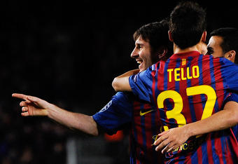 BARCELONA, SPAIN - MARCH 07:  Lionel Messi of FC Barcelona (L) celebrates with his teammate Christian Tello of FC Barcelona after scoring his fifth goal, seventh of FC Barcelona during the UEFA Champions League round of 16 second leg match between FC Barc