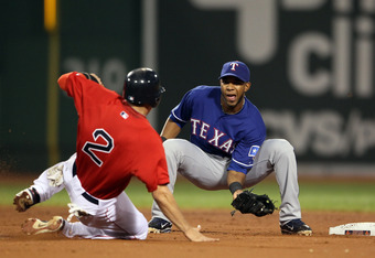 BOSTON, MA - SEPTEMBER 02:  Elvis Andrus #1 of the Texas Rangers catches Jacoby Ellsbury #2 of the Boston Red Sox as he tries to steal second on September 2, 2011 at Fenway Park in Boston, Massachusetts.  (Photo by Elsa/Getty Images)