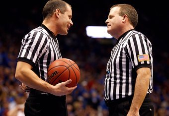 LAWRENCE, KS - FEBRUARY 18:  (L-R) NCAA referees Kipp Kissinger and Gerry Pollard confer during a break in game action between the Kansas Jayhawks and the Iowa State Cyclones on February 18, 2009 at Phog Allen Fieldhouse in Lawrence, Kansas. Kansas defeat