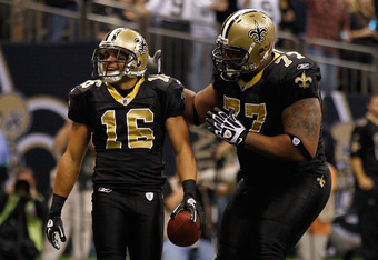NEW ORLEANS, LA - DECEMBER 04:  Wide receiver Lance Moore #16 of the New Orleans Saints celebrates with offensive guard Carl Nicks #77 after scoring in the second quarter against the Detroit Lions at Mercedes-Benz Superdome on December 4, 2011 in New Orle
