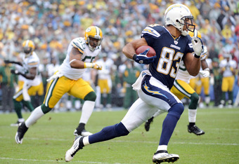SAN DIEGO, CA - NOVEMBER 06:   Vincent Jackson #83 of the San Diego Chargers runs as Desmond Bishop #55 of the Green Bay Packers chases after a catch during the first quarter at Qualcomm Stadium on November 6, 2011 in San Diego, California.  (Photo by Har