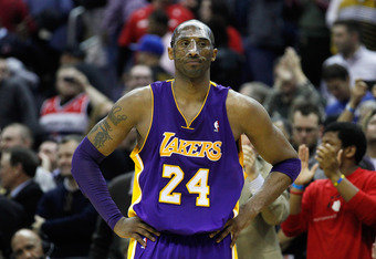 WASHINGTON, DC - MARCH 07:  Kobe Bryant #24 of the Los Angeles Lakers looks on during the closing seconds of the Lakers106-101 loss to the Washington Wizards at the Verizon Center on March 7, 2012 in Washington, DC. NOTE TO USER: User expressly acknowledg