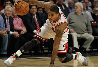 CHICAGO, IL - MARCH 05: Derrick Rose #1 of the Chicago Bulls keeps his balance as he moves against the Indiana Pacers at the United Center on March 5, 2012 in Chicago, Illinois. The Bulls defeated the Pacers 92-72. NOTE TO USER: User expressly acknowledge