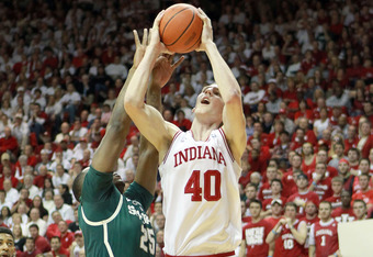 BLOOMINGTON, IN - FEBRUARY 28:  Cody Zeller #40 of the  Indiana Hoosiers shoots the ball while defended by Derrick Nix #25 of the Michigan State Spartans during the Big Ten Conference game at Assembly hall on February 28, 2012 in Bloomington, Indiana.  (P
