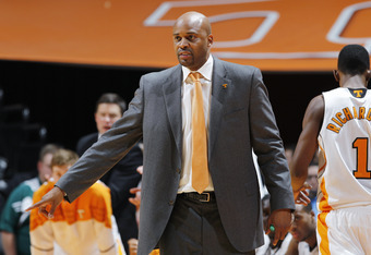 KNOXVILLE, TN - JANUARY 14: Tennessee Volunteers head coach Cuonzo Martin looks on during the game against the Kentucky Wildcats at Thompson-Boling Arena on January 14, 2012 in Knoxville, Tennessee. Kentucky defeated Tennessee 65-62. (Photo by Joe Robbins