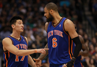 DALLAS, TX - MARCH 06:  Jeremy Lin #17 of the New York Knicks talks with Tyson Chandler during play against the Dallas Mavericks at American Airlines Center on March 6, 2012 in Dallas, Texas.  NOTE TO USER: User expressly acknowledges and agrees that, by