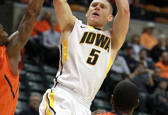 INDIANAPOLIS, IN - MARCH 08: Matt Gatens #5  of the Iowa Hawkeyes shoots during the game against the Illinois Fighting Illini  during the first round of the Big Ten Basketball Tournament at Bankers Life Fieldhouse on March 8, 2012 in Indianapolis, Indiana