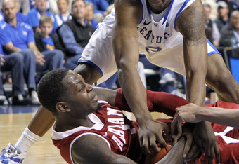 LEXINGTON, KY - JANUARY 21:  Terrence Jones #3 of the Kentucky Wildcats and Jamychal Green#1 of the Alabama Crimson Tide battle for a loose ball during the game at Rupp Arena on January 21, 2012 in Lexington, Kentucky.  (Photo by Andy Lyons/Getty Images)