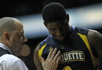 ROSEMONT, IL - FEBRUARY 06: Head coach Buzz Williams of the Marquette Golden Eagles congratulates Jamil Wilson #0 as he's taken out of a game against the DePaul Blue Demons at Allstate Arena on February 6, 2012 in Rosemont, Illinois. Marquette defeated De