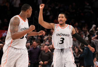NEW YORK, NY - MARCH 08:  Dion Dixon #3 and Yancy Gates #34 of the Cincinnati Bearcats reacts after defeating the Georgetown Hoyas during the quarterfinals of the Big East Men's Basketball Tournament at Madison Square Garden on March 8, 2012 in New York C