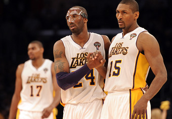 LOS ANGELES, CA - MARCH 04:  Kobe Bryant #24 and Metta World Peace #15 of the Los Angeles Lakers celebrate after a stop in play during a 93-83 Laker win at Staples Center on March 4, 2012 in Los Angeles, California.  NOTE TO USER: User expressly acknowled
