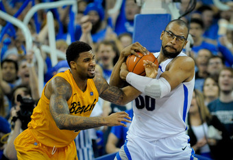 OMAHA, NE - FEBRUARY 18: Gregory Echenique #0 of the Creighton Bluejays fights for the ball with Eugene Phelps #4 of the Long Beach State 49ers during their game at CenturyLink Center February 18, 2012 in Omaha, Nebraska. Creighton beat Long Beach State o