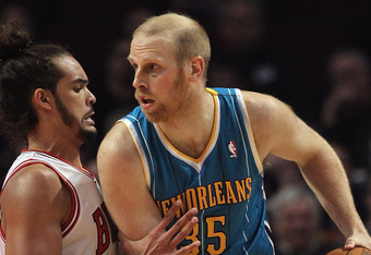 CHICAGO, IL - FEBRUARY 28:  Chris Kaman #35 of the New Orleans Hornets tries to move against Joakim Noah #13 of the Chicago Bulls at the United Center on February 28, 2012 in Chicago, Illinois. The Bulls defeated the Hornets 99-95. NOTE TO USER: User expr