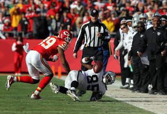 KANSAS CITY, MO - DECEMBER 24:  Brandon Carr #39 of the Kansas City Chiefs breaks up a pass intended for Darrius Heyward-Bey #85 of the Oakland Raiders during the game on December 24, 2011 at Arrowhead Stadium in Kansas City, Missouri.  (Photo by Jamie Sq