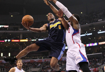 LOS ANGELES, CA - FEBRUARY 02: Arron Afflalo #6 of the Denver Nuggetsgoes up for a shot against DeAndre Jordan #6 of the Los Angeles Clippers at Staples Center on February 2, 2012 in Los Angeles, California.  NOTE TO USER: User expressly acknowledges and