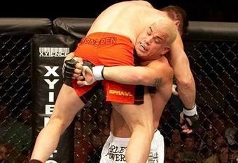 Tito Ortiz prepares to slam Ken Shamrock at UFC 61 (Photos by Zuffa LLC/Zuffa LLC via Getty Images)