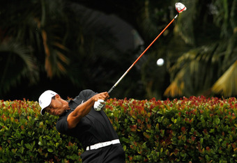 MIAMI, FL - MARCH 08:  Tiger Woods hits his tee shot on the seventh hole during the first round of the 2012 World Golf Championships Cadillac Championship at Doral Golf Resort And Spa on March 8, 2012 in Miami, Florida.  (Photo by Mike Ehrmann/Getty Image