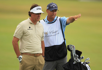 MIAMI, FL - MARCH 08:   Phil Mickelson chats with his caddie Jim Mackay on the 18th hole during first round of the World Golf Championships-Cadillac Championship on the TPC Blue Monster at Doral Golf Resort And Spa on March 8, 2012 in Miami, Florida.  (Ph