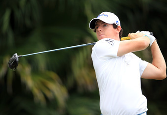 MIAMI, FL - MARCH 08:  Rory McIlroy of Northern Ireland plays his tee shot at the par 5, 12th hole during the first round of the World Golf Championship Cadillac Championship on the TPC Blue Monster Course at Doral Golf Resort And Spa on March 8, 2012 in