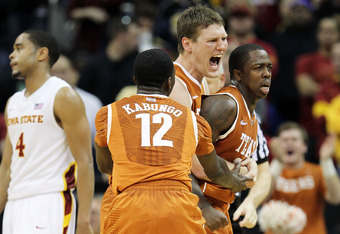 KANSAS CITY, MO - MARCH 08:  Clint Chapman #53 and Myck Kabongo #12 of the Texas Longhorns celebrate with J'Covan Brown #14 after Brown scored late during the NCAA Big 12 basketball tournament quarterfinal game against the Iowa State Cyclones on March 8,