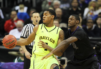 KANSAS CITY, MO - MARCH 08:  Perry Jones III #1 of the Baylor Bears controls the ball against the defense of Jamar Samuels #32 of the Kansas State Wildcats during the quarterfinals of the 2012 Big 12 Men's Basketball Tournament at Sprint Center on March 8
