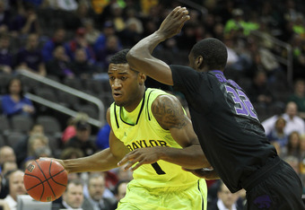 KANSAS CITY, MO - MARCH 08:  Perry Jones III #1 of the Baylor Bears drives against Jamar Samuels #32 of the Kansas State Wildcats during the quarterfinals of the 2012 Big 12 Men's Basketball Tournament at Sprint Center on March 8, 2012 in Kansas City, Mis