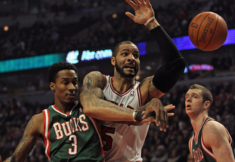 CHICAGO, IL - FEBRUARY 22: Carlos Boozer #5 of the Chicago Bulls and Brandon Jennings #3 of the Milwaukee Bucks battle for a loose ball at the United Center on February 22, 2012 in Chicago, Illinois. NOTE TO USER: User expressly acknowledges and agrees th