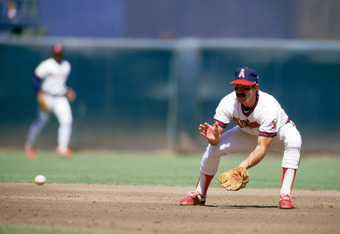 ANAHEIM, CA - 1985:  Infielder Bobby Grich #4 of the California Angels fields a grounder during a 1985 season game at Angel Stadium in Anaheim, California.  (Photo by Rick Stewart/Getty Images)