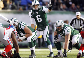 EAST RUTHERFORD, NJ - DECEMBER 24:  Mark Sanchez #6 of the New York Jets calls a play during a game against the New York Giants at MetLife Stadium on December 24, 2011 in East Rutherford. New Jersey. The Giants won 29 - 14. (Photo by Rich Schultz/Getty Im