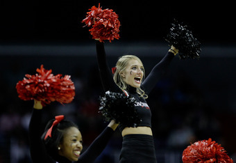 WASHINGTON - MARCH 19:  A Cincinnati Bearcats cheerleader performs during their game against the Connecticut Huskies during the third round of the 2011 NCAA men's basketball tournament at Verizon Center on March 19, 2011 in Washington, DC.  (Photo by Rob